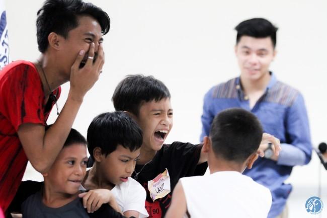 Children express enjoyment during the fiesta's Children's Hour. Photo by Kent Matthew Te