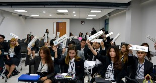 Delegates representing the different member states of the United Nations (UN) raise their placards during a plenary voting procedure. Photo from the official Facebook page of International Studies Department, Ateneo de Davao University